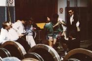"""Festa al deposito F.S. di Bologna per la presentazione del LP di LMT: """"Bravi Ma Basta"""", 1988.Tra i vari ospiti (Boo Hoos, Rockin' Chairs, amici e conoscenti, ecc) anche una mitica esibizione dei Banaloidi e degli Spietati Cetriolini che si unirono storicamente insieme per una performance. Il mago Cama (coi guanti bianchi) sembra dirigere il coro degli alpini! In primo piano enormi ruote ferroviarie su un binario morto. #LMT #iBanaloidi #Linoeimistoterital #BraviMaBasta #records #vinyle #Eighties #80s' #FS #trains #railways"""